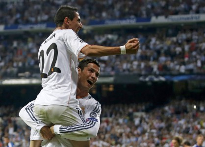 Real Madrid's Ronaldo celebrates his goal against FC Copenhagen with team-mate Di Maria during their Champions League soccer match in Madrid
