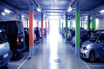 Backlit indoor car parking in blue cold light shiny floor
