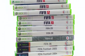 SWINDON UK - DECEMBER 2 2014: Collection of FIFA Football games by EA Sports from 2003 until 2015 for the XBox console