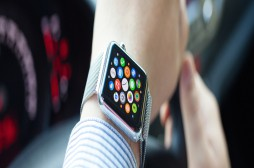 Alushta Russia - September 3 2015: Man hand in the car with Apple Watch and app Icon on the screen. Apple Watch was created and developed by the Apple inc.
