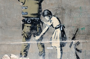 BETHLEHEM PALESTINIAN TERRITORIES - JANUARY 25: Banksy grafitti on a wall in the occupied territories. Bethlehem JANUARY 25 2010.