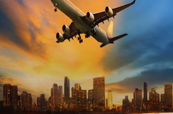 beautiful lighting of vehicle in land transportation and passenger jet plane flying above urban scene use for transport business and people traveling theme ** Note: Visible grain at 100%, best at smaller sizes