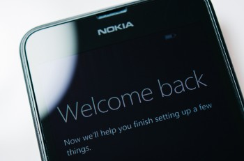 LONDON UNITED KINGDOM - NOVEMBER 9 2014: Nokia Lumia Windowsphone smartphone display with Welcome Back text. Microsoft has announced that it will stop using Nokia branding on all future mobile phones