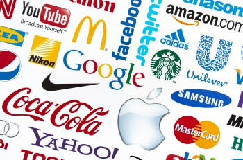 KIEV, UKRAINE - FEBRUARY 21, 2012: A logotype collection of well-known world brand's printed on paper. Include Google, McDonald's, Nike, Coca-Cola, Facebook, Apple and more others logo.