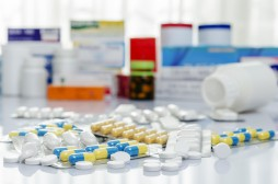 Variety of medicines and drugs on table