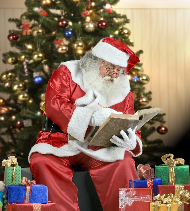 A real Santa Claus portrait checking his list