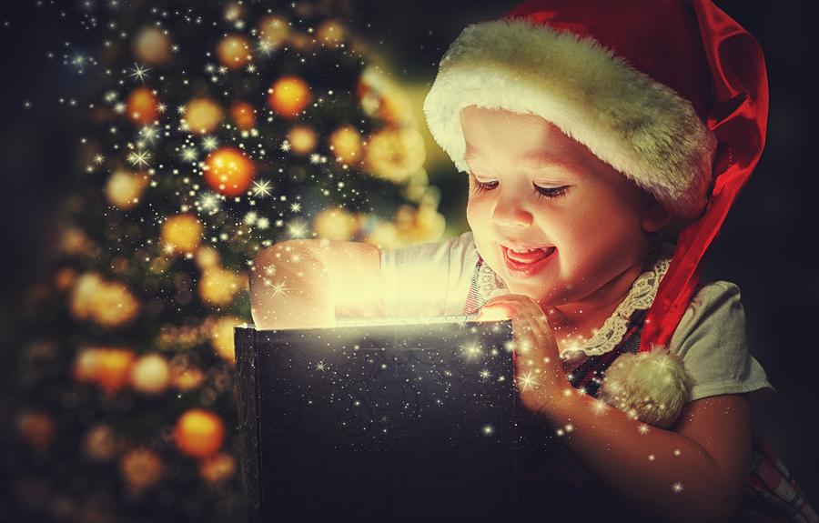 Christmas miracle magic gift box and a child baby girl