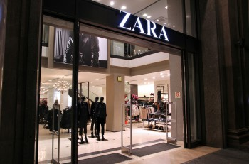 BARCELONA SPAIN - NOVEMBER 5: People visit Zara store on November 5 2012 in Barcelona Spain. Zara has 1763 stores and had more than 7 billion EUR revenue in 2009.