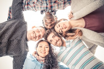 Group of friends in circle looking down - Multiethnic people smiling and having fun at party- Concepts about summerlifestyle and happiness