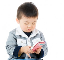 Little boy watching on mobile