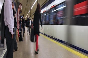 MADRID SPAIN - OCTOBER 23 2012: People wait for Madrid Metro. Madrid Metro has annual ridership of 634 million passengers (2011).