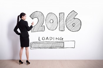 New Year is loading now - Back view of business woman writing 2016 new year on white wall background