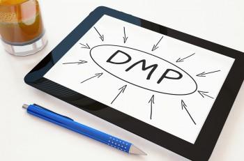DMP - Data Management Platform or Debt Management Plan - text concept on a mobile tablet computer on a desk - 3d render illustration.