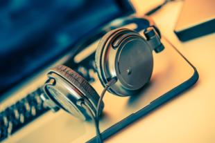 Headphones on Laptop Computer. Online Music Listening. Music Concept. ** Note: Shallow depth of field