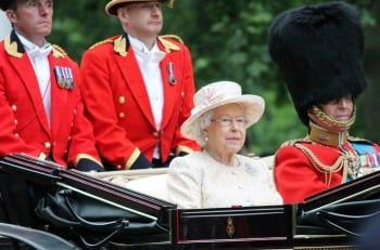 LONDON, England - JUNE 13 2015: Queen Elizabeth II and Prince Philip seat on the Royal Coach at Queen's Birthday Parade, Trooping the Colour on June 13, 2015 in London, England.