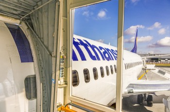 FRANKFURT GERMANY - JULY 6 2015: Boarding Lufthansa Jet airplane in Frankfurt airport. Lufthansa is the largest airline in Europe for overall passengers carried.
