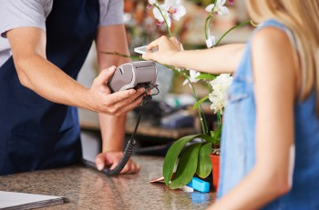 Mobile Payment with smartphone at checkout in nursery retail store