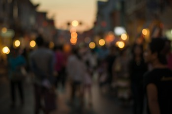 People in bokeh Crowd of people in Talang Road during night life Phuket Thailand