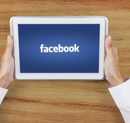 Digital Tablet With Facebook Logo On The Screen