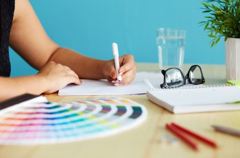 Graphic designer at sketching the web design