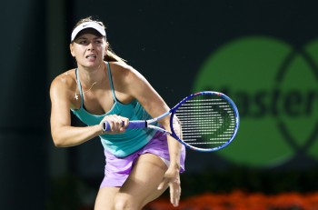 KEY BISCAYNE, FL-MAR 26: Maria Sharapova of Russia returns a shot during day four at the Miami Open at Crandon Park Tennis Center on March 26, 2015 in Key Biscayne, Florida.
