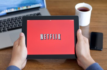 Male Hands Holding Ipad With App Netflix On The Screen In The Of