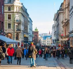 OSLO NORWAY - JANUARY 29: People walking along the street in Oslo downtown in sunny winter day. Taken in Oslo January 29 2015.