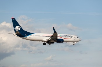 MIAMI, USA - April 29, 2015: Boeing 737 Aeromexico landing at Miami International Airport. Aeromexico is the flag carrier airline of Mexico and the biggest Mexican Airline.