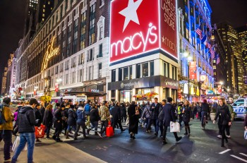 NEW YORK-DECEMBER 21: A large crowd of shoppers and tourists in Herald Square near Macy's on December 21 2015 in New York City.