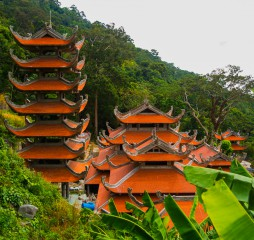 Pagoda in Ta Cu mountain Binh Thuan province Vietnam.Temples..Asia. Vietnam.Phan Thiet.summer.Mountains in the distance and green leaves on the trees.