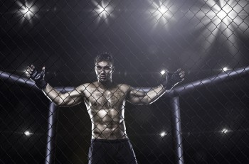 fighter in mma cage arena front view