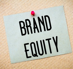 Recycled paper note pinned on cork board. Brand Equity Message. Concept Image