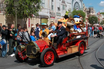 disney characters on an old automobile parading in disneyland los angeles california. The picture was taken on Apr 9 2011