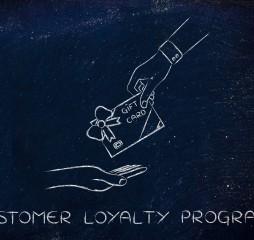 hand giving gift card, customer loyalty programs