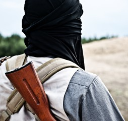 Muslim rebel with automatic rifle and machine-gun belt ** Note: Shallow depth of field
