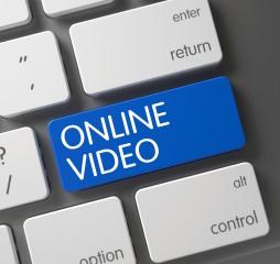 Concept of Online Video, with Online Video on Blue Enter Key on Aluminum Keyboard. Key Online Video on Aluminum Keyboard. Online Video CloseUp of Slim Aluminum Keyboard on Laptop. 3D.
