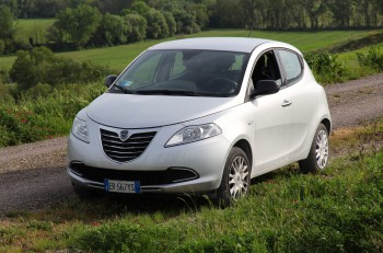 SIENA ITALY - MAY 3 2015: Lancia Ypsilon small hatchback car parked in Siena countryside Italy. Lancia is part of Fiat Chrysler Automobiles 7th largest auto maker in the world.