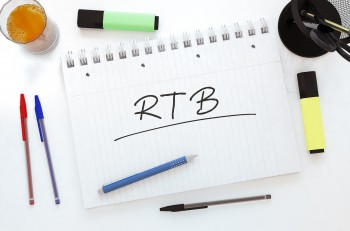 RTB - Real Time Bidding - handwritten text in a notebook on a desk - 3d render illustration.