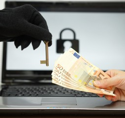 hacker gives key to victim to restore the personal data on laptop computer