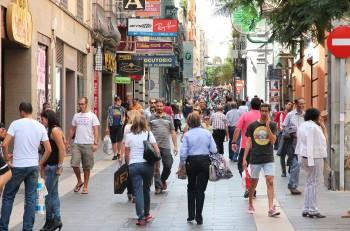 SANTA CRUZ DE TENERIFE SPAIN - OCTOBER 27 2012: People visit shopping area in Santa Cruz Spain. Santa Cruz is the largest city on the island of Tenerife with 222417 people.