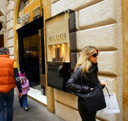 ROME - MARCH 13:  Luxury shopping along Via Condotti in Rome, Italy, on March 13, 2005. Shoppers pass a Gucci shop.