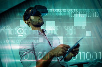 Blue technology design with binary code against businessman using an oculus