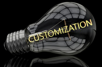 Customization - lightbulb on black background with text in it. 3d render illustration.
