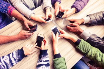 Top view hands circle using phone in cafe - Multiracial friends mobile addicted interior scene from above - Wifi Connected people in bar table meeting - Concept of teamwork main focus on left phones