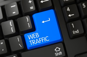 A Keyboard with Blue Keypad - Web Traffic. Button Web Traffic on Modernized Keyboard. Black Keyboard with the words Web Traffic on Blue Button. 3D Illustration.