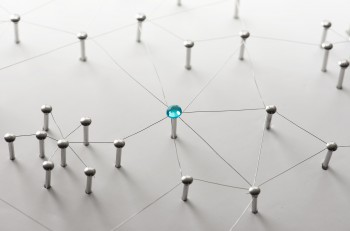 Linking entities. Network, networking, social media, connectivity, internet communication abstract. Web of thin silver wires on white background. Key Person or network hub.
