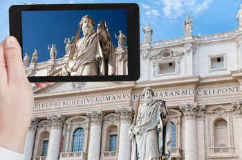 travel concept - tourist taking photo of Statue of Apostle Paul in Vatican on mobile gadget Rome Italy