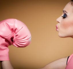 Female Boxer Wearing Big Fun Pink Gloves Playing Sports