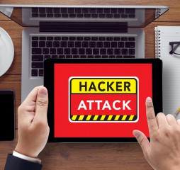 Warning Hacker Attack Browsing Concept on the tablet pc screen held by businessman hands - online top view