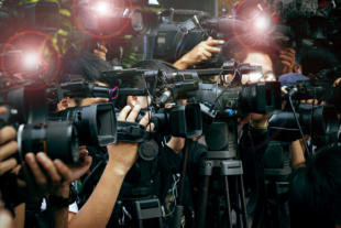 press and media camera video photographer on duty in public news coverage event for reporter and mass media communication
